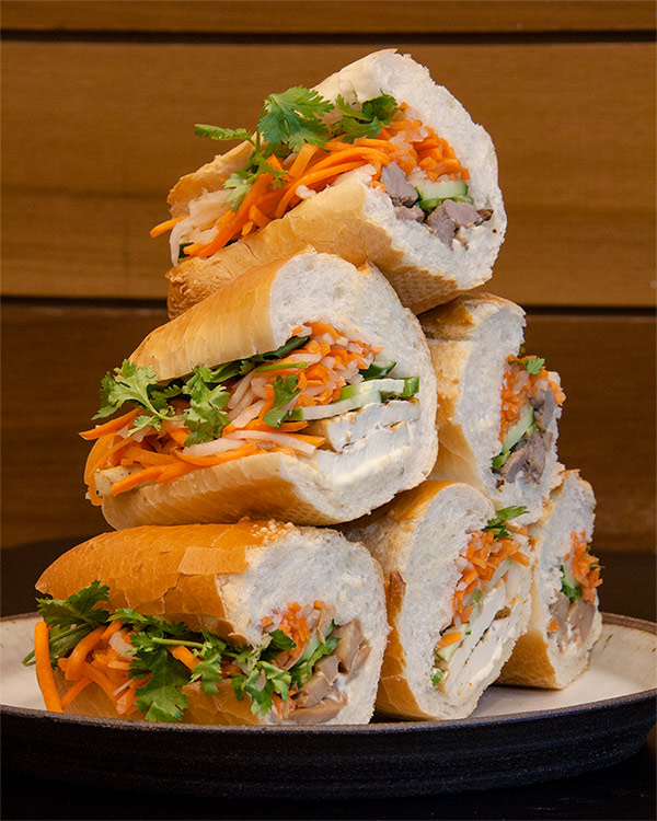 Stack of banh mi sandwiches in meat and meatless varieties
